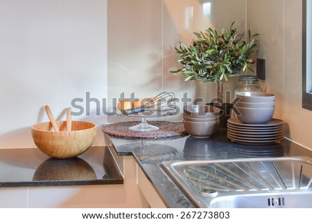 Ceramic kitchenware on the black granite counter top - stock photo