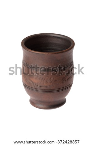 Ceramic mug without a handle on a white background - stock photo
