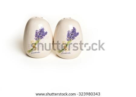 ceramic pepper-box and salt cellar with lavender print - stock photo