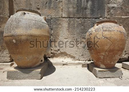 Ceramic pots in Phaestos city ruins in Crete. Greece. Horizontal - stock photo