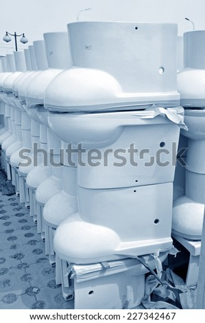 Ceramic products are neatly stacked together  - stock photo