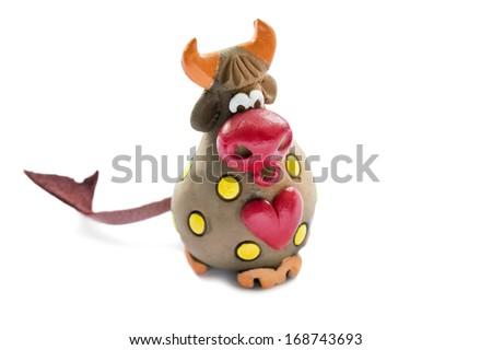 Ceramic souvenir bull on white background - stock photo