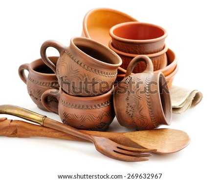 Ceramic tableware on white background - stock photo