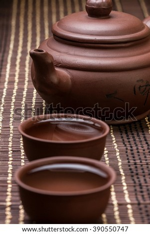 ceramic teapot and two cups for the tea ceremony on the bamboo napkin  - stock photo
