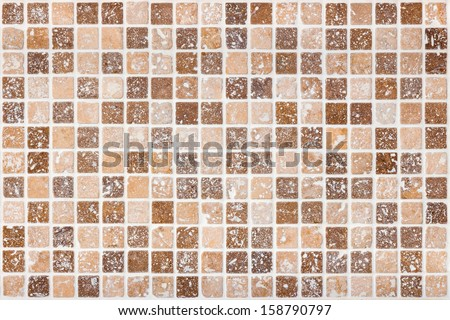 Ceramic tile background. Brown and beige square tiles. - stock photo