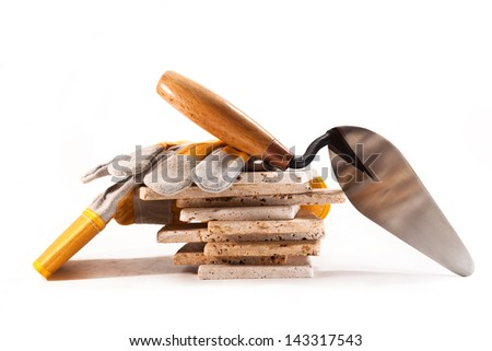 Ceramic tile, trowel and gloves on a white background - stock photo