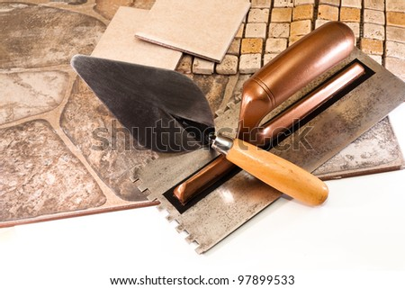 Ceramic tiles, mosaic and stone tool for the job tiler - stock photo