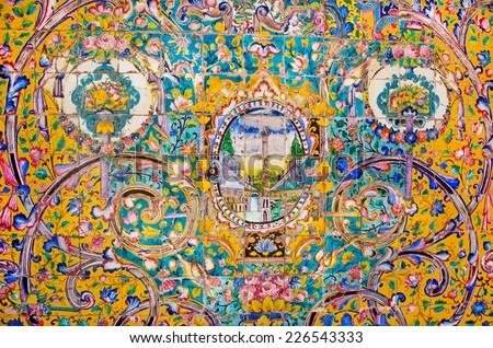 Ceramic tiles with traditional Persian patterns on the beautiful walls of the old royal palace in Iran - stock photo