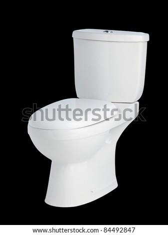 Ceramic toilet bowl on black background - stock photo