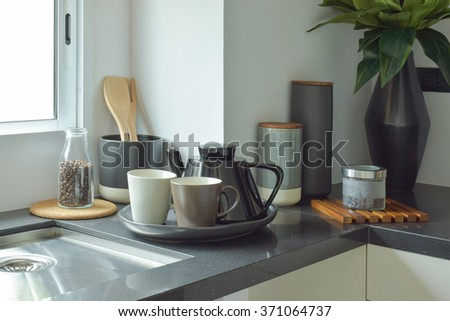 Ceramic ware on black counter top in the kitchen - stock photo
