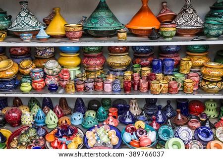 Ceramicl utensil on Moroccan souvenir shop, tajines - stock photo