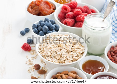 cereal and various delicious ingredients for breakfast, horizontal, close-up - stock photo