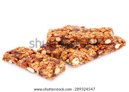 Cereal bars with different nuts isolated on white background. - stock photo