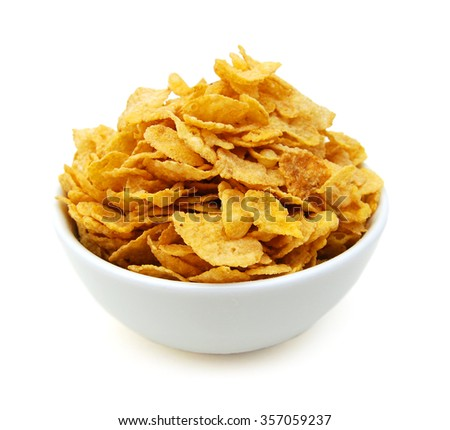 Cereal flakes in white bowl on white background - stock photo
