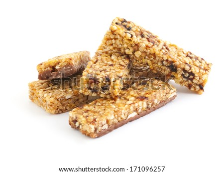 Cereal muesli bars with dried fruits isolated on white - stock photo