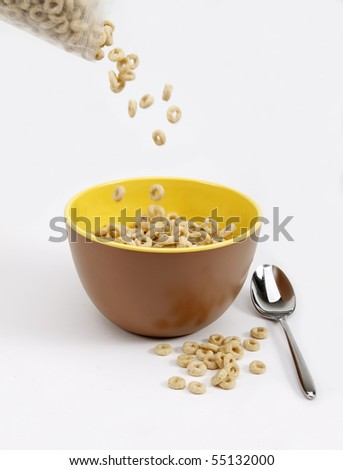 Cereal pouring into a bowl - stock photo