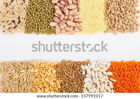 Cereals, seeds, beans - border on white background  - stock photo