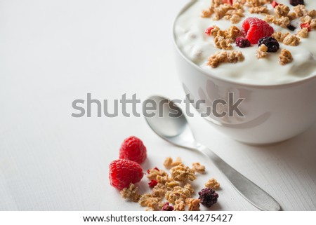 Cereals with yogurt in bowl - stock photo