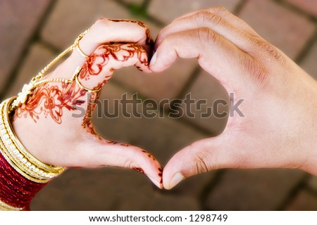 ceremonial wedding hands in shape of heart one male one female coming together to form heart - stock photo