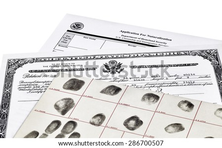 Certificate of Citizenship, fingerprint card and application for naturalization, isolated on white - stock photo