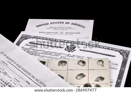 Certificate of US Citizenship, fingerprint card, Declaration of Intention and Passenger Manifest documents isolated on white - stock photo