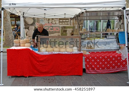 CERVIA, ITALY-MARCH 27, 2016: cheese stand at the village Sunday market. This market is very popular and attract thousands of tourists. - stock photo