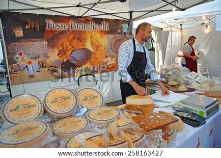 CERVIA, ITALY-SEPTEMBER 21, 2014: Sogliano pit cheese  stand at the annual International food outdoor market. This market is very popular and attract thousands of tourists. - stock photo