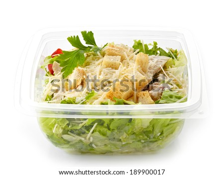 cesar salad in a plastic take away box isolated on white - stock photo