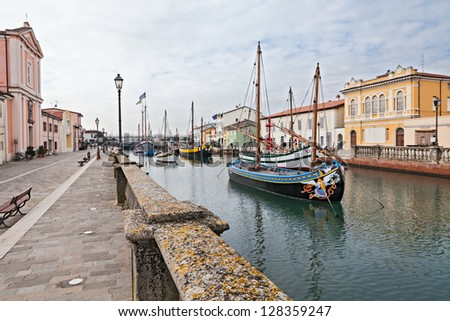 Cesenatico, seaside town in Italy, where ancient fishing sailing boats are displayed in the canal - stock photo