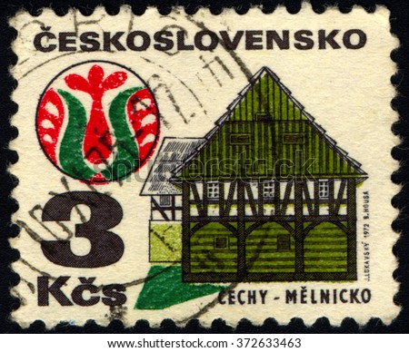 CESKOSLOVENSKO - CIRCA 1972: A stamp printed in Czechoslovakia shows town Melnik in Bohemian region, house and folk art, circa 1972 - stock photo