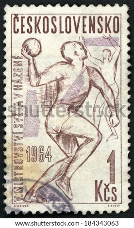 CESKOSLOVENSKO - CIRCA 1964: post stamp printed in Czechoslovakia (Czech) shows 2 male field ball (handball) players; world field ball championships, Scott 1219 A467 1k brown, circa 1964 - stock photo