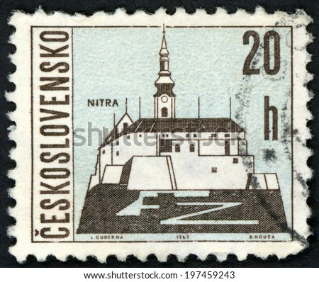 CESKOSLOVENSKO - CIRCA 1965: post stamp printed in Czechoslovakia (Czech) shows Nitra castle on mountain in Slovakia from views of towns; Scott 1347 A516 20h blue black, circa 1965 - stock photo