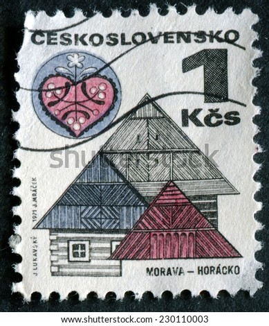 CESKOSLOVENSKO - CIRCA 1971: post stamp printed in Czechoslovakia (Czech) shows ornamental roofs and folk art, town Horacko in Moravia region; Scott 1733 A630 1k blue red, circa 1971 - stock photo