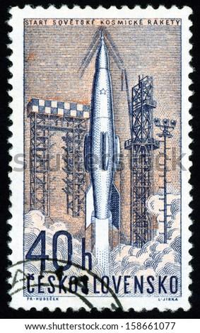 CESKOSLOVENSKO - CIRCA 1962: stamp printed in Czech (Czechoslovakia) shows launching of Soviet space rocket; space research series, Scott 1106 A422 40h blue salmon orange, circa 1962 - stock photo