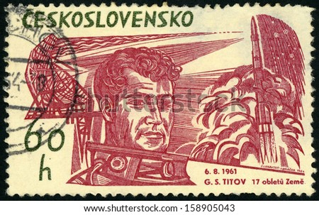 CESKOSLOVENSKO - CIRCA 1965: stamp printed in Czech (Czechoslovakia) shows Soviet cosmonaut Gherman Titov (first  person to orbit Earth multiple times - 17); Scott 1234 A472 60h green red, circa 1965 - stock photo