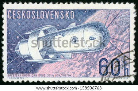 CESKOSLOVENSKO - CIRCA 1962: stamp printed in Czech (Czechoslovakia) shows Soviet Spaceship Vostok 2; space research series, Scott 1107 A423 60h blue pink, circa 1962 - stock photo
