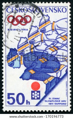CESKOSLOVENSKO - CIRCA 1972: stamp printed in Czech republic (Czechoslovakia) shows figure of man ski jumping, 11th winter Olympic games Sapporo Japan; Scott 1797 A647 50h blue yellow red, circa 1972 - stock photo