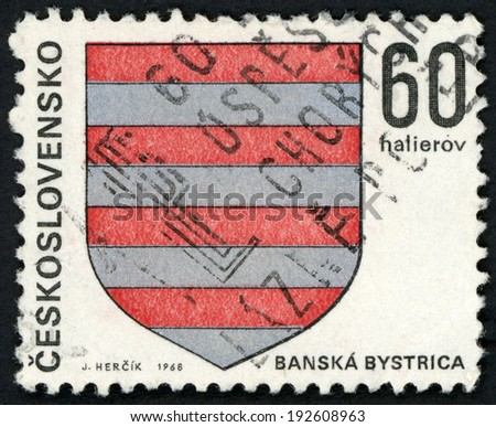CESKOSLOVENSKO - CIRCA 1968: stamp printed in Czechoslovakia (Czech; Slovakia) shows coat of arms of regional capitals; Banska Bystrica; stripes on shield; Scott 1569 A590 60h red gray, circa 1968 - stock photo