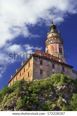 Cesky Krumlov (Krumau) - historic town in Czech Republic. Picturesque, colorful view on tower of castle Cesky Krumlov in sunny day. UNESCO World Heritage Site. Summer vacation concept. Copy spase.  - stock photo