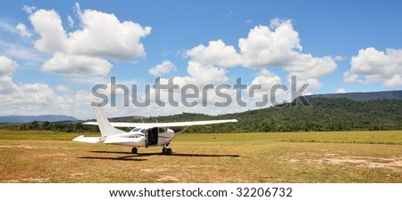 Cessna plane on the unpaved airfield - stock photo