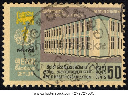 CEYLON - CIRCA 1968: A stamp printed in Ceylon issued for the 20th anniversary of World Health Organization shows Institute of Hygiene, circa 1968. - stock photo
