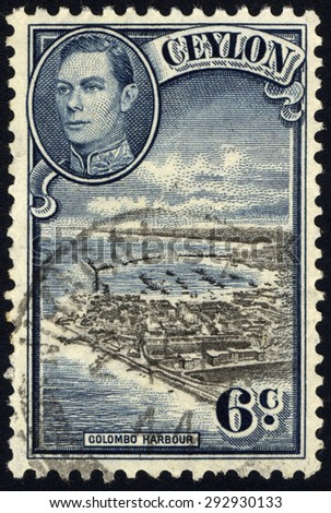 CEYLON-CIRCA 1937:A stamp printed in CEYLON shows image of The Colombo Harbour (known as Port of Kolomtota) is the largest and busiest port in Sri Lanka, circa 1937. - stock photo