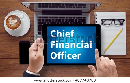 CFO    Chief Financial Officer, on the tablet pc screen held by businessman hands - online, top view - stock photo