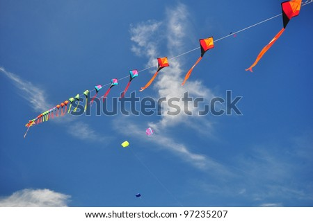 CHA-AM - MARCH 9: Colorful kites in  the 12th Thailand International Kite Festival on March 9, 2012 in Naresuan Camp, Cha-am, Thailand. - stock photo