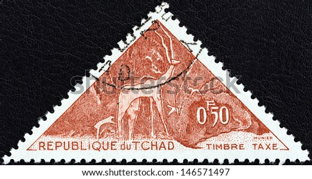 "CHAD - CIRCA 1962: A stamp printed in Chad from the ""Prehistoric petroglyphs"" issue shows Kudu, circa 1962.  - stock photo"