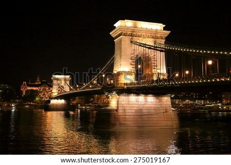 Chain bridge with shining pillars above Danube river at night, Budapest, Hungary - stock photo