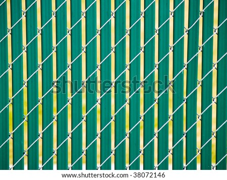 Chain link fence with plastic, green privacy strips - stock photo