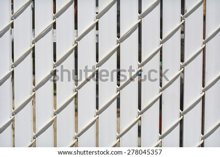 Chain Link fence with privacy slats Linked Fence Winged Slats for Chain Link Fences Metallic Fence - stock photo
