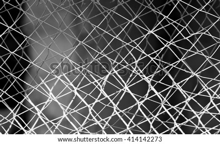 chain-link fencing on the black-white - stock photo