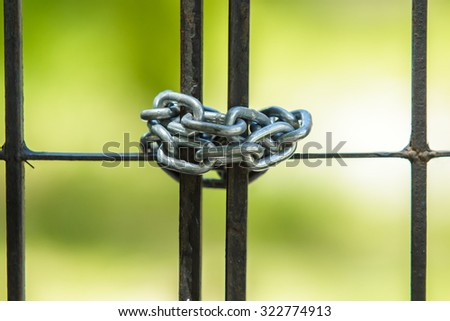 Chain lock the gate. - stock photo
